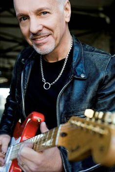 Peter Frampton..still playing so well..and looking good. Miss the hair.
