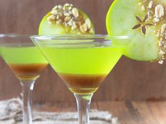 Spoon cooled caramel into each of 2 martini glasses. Place glasses in freezer while making martinis. In martini shaker, place 2 cups of ice - 2 oz sour apple-flavored schnapps - 2 oz butterscotch-flavored schnapps - 2 oz apple- or vanilla-flavored vodka; shake well. Strain into chilled martini glasses. Garnish with caramel-dipped apple slices.