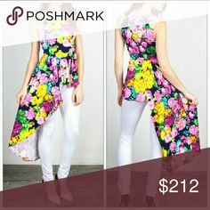 FLORAL peplum top Colorful floral top with peplum feature that is longer on 1 side. Multi colored  New, no tags 97%rayon 3% spandex Price is firm Tops