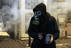 A masked demonstrator clashes with riot police following the funeral of Berkin Elvan in Istanbul on March 12, 2014. (AP Photo/Emrah Gurel)