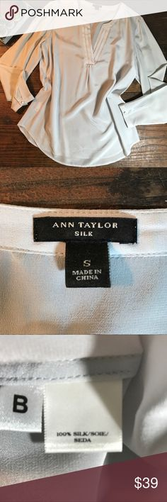 Ann Taylor Pale Grey Silk V Neck Blouse Please see photos for bust/length measurements as well as fabric/care instructions. Pleating at neckline. Covered buttons at cuff. Slight shirttail hem. Perfect under a blazer for career wear. In EUC. Ann Taylor Tops Blouses