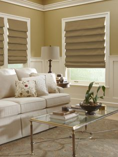 Waterfall style, hobbled roman shades add dimension and visual interest to this traditional living space.