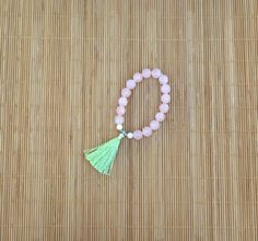 Items similar to Semi Precious Rose Quartz Prayer Bead Style Stretch Bracelet With a Celery Green Tassel and Chrysoprase Stone on Etsy Prayer Beads, Stretch Bracelets, Handmade Bracelets, Rose Quartz, Tassel Necklace, Tassels, Stone, Green, Etsy
