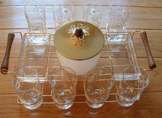 Vintage Barware Set Eight Highball Glasses Atomic Starburst, Ice Bucket, Caddy / Carrier, Appetizer Dishes.  via Etsy.