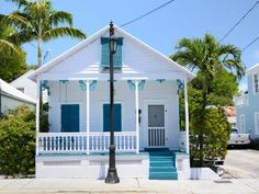 Playful seaside hues and fanciful design details enliven the cute cottages found on Florida's Key West island.