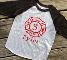 Custom Fireman Birthday Shirt | Fire Truck Birthday Party by WanderingPeacockCo on Etsy https://www.etsy.com/listing/512985429/custom-fireman-birthday-shirt-fire-truck