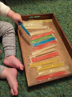 13. Ice pops sensory play.    This is a great activity for educating young senses. It can introduce toddlers to a concept of cold/frozen, they can learn about colors, length, shape. This can be a great vocabulary lesson if you talk about these qualities of ice pops. As children learn to connect words with objects, the world take on a new meaning for them
