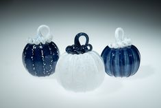Dark Blue Glass Pumpkin with white stem and white glass frit on ridges, This piece is one of our smaller pumpkins, they range in size from 3-4 inches. For these pumpkins we roll through a little white frit on the surface, frit is small chips of glass that give the piece a little extra sparkle. This is a great fall wedding gift, Fall decor, gift for mom, gift for a friend, gift for dad, fall wedding gift, anniversary gift, gift for a coworker, or just a nice little pumpkin for you! Small Pumpkins, Glass Pumpkins, Thanksgiving Decorations, Halloween Decorations, Fall Wedding, Wedding Gifts, Corning Museum Of Glass, Fall Gifts, Little Pumpkin