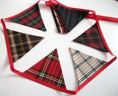 Mixed tartan bunting on red tape