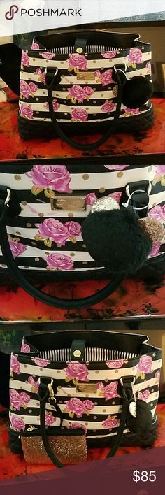 Betsy Johnson tote new with tags. has change pouch wrislet.attached and cat pom. snap closure.with multiple pockets and no scratches to hard ware.  never used. gorgeous bag. perfect for spring. 11x16x6. pouch is 6x4. Betsey Johnson Bags Totes