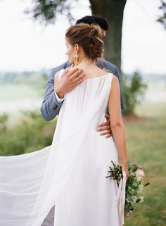 Romantic bride and groom at Verulam Farm in Charlottesville, VA. Bouquet by Mallory Joyce. Image by Eric Kelley.