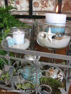 A summer seaside centerpiece!CLEAR BOWLS, COLORED LAYERED SAND , DECORATE CANDLES, ADD SHELLS, GLASS FLOATS,ETC