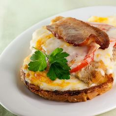 Kentucky Hot Brown! Recipe Main Dishes with unsalted butter, all-purpose flour, whole milk, cheddar cheese, parmesan cheese, ground nutmeg, ground black pepper, salt, large eggs, milk, salt, white bread, butter, vegetable oil, turkey breast, tomatoes, cheddar cheese, freshly grated parmesan, bacon, flat leaf parsley