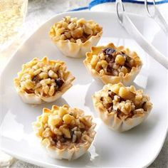 Baklava Tartlets Recipe -Want a quick treat that's delicious and easy to do? These tartlets will do the trick. You can serve them right away, but they're better after chilling for about an hour in the refrigerator. —Ashley Eagon, Kettering, Ohio