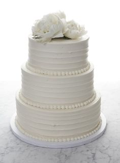 Perhaps without the flowers, or maybe orchids instead?  Classic Wedding Cake by Baked NYC