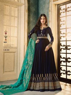 Navy Blue And Turquoise Motif Embroidered Ghera Anarkali Suit is especially crafted for showcasing glamorous style and ethnic elegance with its unique motifs embroidered combination of beautiful zari and thread work annotated perfectly on flared satin geo Robe Anarkali, Costumes Anarkali, Anarkali Suits, Lehenga, Anarkali Churidar, Indian Anarkali, Lehnga Dress, Punjabi Suits, Pakistani