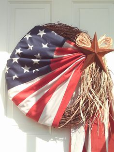 """Primitive Patriotic Flag Wreath Done on an grapevine wreath.I use an America flag with a rusty star on the side of it The bottom of the flag hangs from the star"""" This will make a great primitive wreath for your front door for the Patriotic holidays. Patriotic Wreath, Patriotic Crafts, Patriotic Decorations, July Crafts, 4th Of July Wreath, July 4th Holiday, Fourth Of July, Holiday Fun, Thanksgiving Holiday"""