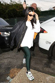 Gallant: It was a rainy day in Los Angeles that day and a gentleman in black could be seen holding an umbrella for Kourtney as she emerged from her car Green Leggings, Kris Jenner, Kourtney Kardashian, Keep Up, Gentleman, Bomber Jacket, Sporty, Casual, Model