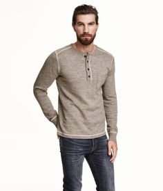 Henley sweater in soft, fine-knit cotton with a button placket and a chest pocket.