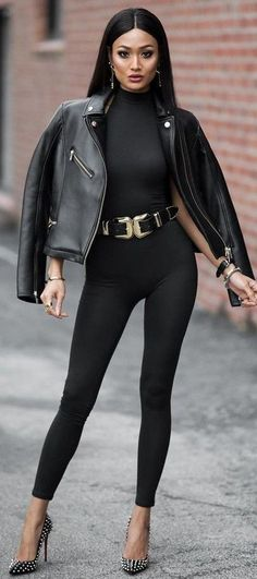 A black leather biker jacket and black leggings will convey a carefree, cool-girl vibe. Elevate your getup with black studded leather pumps.   Shop this look on Lookastic: https://lookastic.com/women/looks/biker-jacket-turtleneck-leggings/23362   — Black Turtleneck  — Black Leather Biker Jacket  — Black Leather Waist Belt  — Black Leggings  — Black Studded Leather Pumps