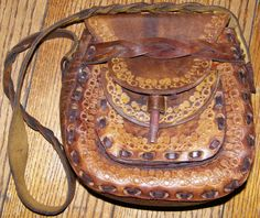 TOOLED PURSE 60s 70s era, Vintage Boho HIppie  Leather Shoulderbag, Unique Style Bag Design. $69.99, via Etsy.
