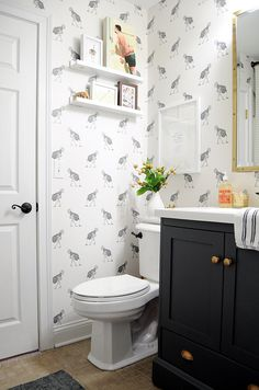 I wish I had a powder room for a fun printed wallpaper!  Ostrich Wallpaper Powder Bath Black and White