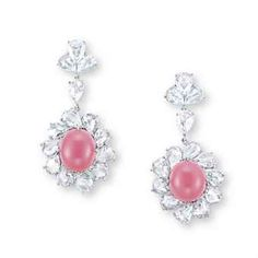 A PAIR OF CONCH PEARL AND DIAMOND EAR PENDANTS. Sold US$189,316 at Christie's Hong Kong, Nov 2012.