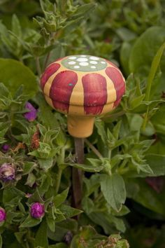 paint an old door knob and mount on a stake for unique garden art