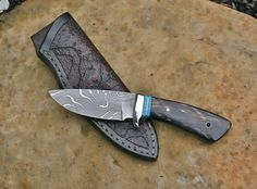 Custom hunting knife with special etch on 8670 carbon tool steel, water buffalo and turquoise handle. Custom knife