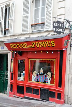 Refuge de Fondues in Montemarte Paris.  Where fondue is the only thing on the menu, wine is served in baby bottles, and you have to climb over tables to get to your seat.  It was the most fun.