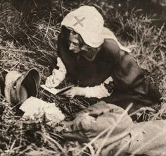 A Red Cross nurse writes down the last words of a British Soldier. 1917, somewhere on the Western Front