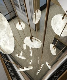 SOHO - Atelier Alain Ellouz Two discs held together in a vertical suspension. - SOHO – Atelier Alain Ellouz Two discs held together in a vertical suspension. Rustic Lighting, Cool Lighting, Interior Lighting, Lighting Ideas, Lighting Stores, Luxury Lighting, Lighting Solutions, Home Design, Modern House Design