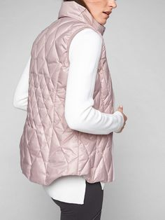 Made with responsibly sourced down, this insulation piece features recycled fabric and is water- and wind-resistant.