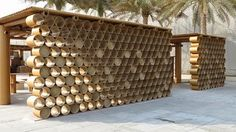 Known as the Design Souq by Shigeru Ban Architects, this amazing architecture is one of masterpieces that was made by cardboard tubes in Abu Dhabi Art festival Architecture Design, Temporary Architecture, Paper Architecture, Pavilion Architecture, Classical Architecture, Flur Design, Nachhaltiges Design, Kiosk Design, Design Studio