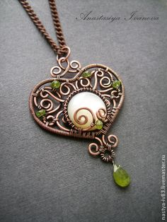 Pendant is made ​​of copper wire, pearl , beads and vessonita chrysotile , patinated and polished. Anastasia Ivanova