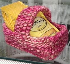 Free Knitting Pattern for Tea Bag Basket - Easy basket by Knitvana that is great for scrap yarn and quick gifts. . Pictured project by Lauriebo who put the handle across the middle. Also a great Easter treat basket!