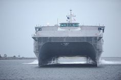 The Military Sealift Command joint high-speed vessel USNS Spearhead (JHSV-1) pulls into Naval Station Mayport to be inspected by Rear Adm. Sinclair M. Harris, commander of U.S. 4th Fleet. (U.S. Navy photo by Mass Communication Specialist 3rd Class Damian Berg/Released)