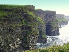 "The Cliffs of Moher are located in Ireland on the south-western edge of The Burren. These cliffs are also referred to as the Cliffs of Coher; their Irish name Aillte an Mhothair translates to ""cliffs of the ruin.""  The Cliffs of Moher range in elevation from 394 feet (120 m) to 702 feet (214 m). The cliffs are comprised mostly of beds of Namurian shale and sandstone. The cliffs are home to over 30,000 birds from 29 different species. [Seven Natural Wonders of Europe]"