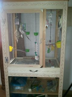A bird cage I designed and made out of an old entertainment center we got at a garage sale!
