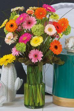 Colourful gerberas in a green vase #yellowgerberas #orangegerberas #inspiration #colouredbygerbera #dutchgerbera