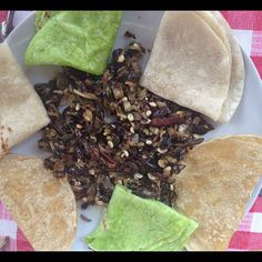 Mexican bugs for food! Chinicuiles, Chapulines, snails and escamoles... it looks yummy served here with flat breads
