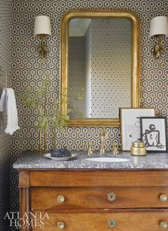 Room by Michelle Smith One of the places in the home my clients are the most apt to really venture out of their comfort zone is the powder room. It's scary to make a big bet on a larger room, so the powder room is a place people seem to go bigger… Powder Room Vanity, Powder Room Wallpaper, Bathroom Wallpaper, Of Wallpaper, Pattern Wallpaper, Powder Rooms, Geometric Wallpaper, David Hicks, Downstairs Bathroom