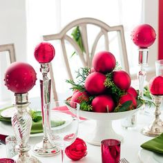 Pyramid of ornaments - Create a pyramid of solid-color ball ornaments on top of a compote. Use a hot-glue gun or scrapbooking glue dots to adhere ball ornaments to each other. Fill in with loose evergreens. To complete the look, top candlesticks and votive holders with matching ball ornaments.