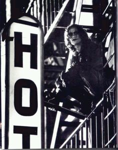 Brandon Lee as The Crow. I feel like the conveniently cropped sign is trying to tell me something...