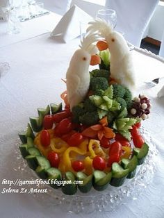 Fruit Carving - Vegetable Carving  - Fruit Carving Arrangements and Food Garnishes: Vegetable Plate And a Pair Of Carved Birds. Using Cucumber Garnishes