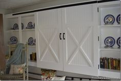 Cabinet & bookshelves - up off the floor above heat register - possibly good concept even though we do not have this style of heater.    barn door inspired closet doors, Four Generations One Roof