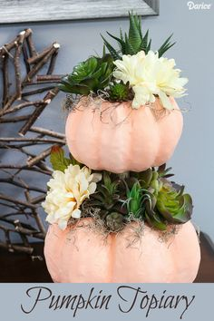Dress up paper mache pumpkins by turning them into a DIY pumpkin topiary for fall! Add moss, faux succulents and mums to complete the autumnal look.