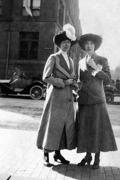 I don't know what I like most about this photo - the two ladies in awesome outfits and hats, or the really sleek car in the background. :)    Friends 1912