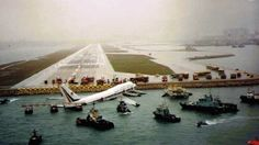 China Airlines 747 sits in the water after skidding off the runway at Kai Tak airport in Hong Kong Nov. 1993. (GIS/AFP/Getty Images)