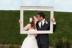 I want this same shot but with the flower girl and ring bearer holding the frame with us framed in the background.